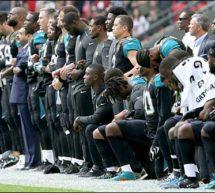 ٹرمپ کی دھمکیاں، سیا ہ فام کھلاڑیوں کا گھٹنوں کے بل بیٹھ کر احتجاج